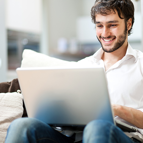 Excited trader behind laptop